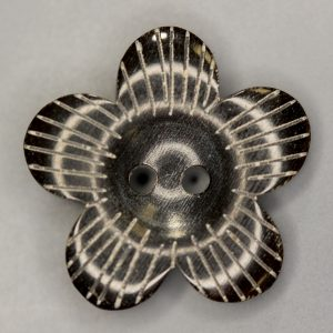 Black flower shaped horn button with rustic engraving