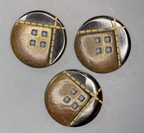 Three Brown horn buttons with yellow stitching