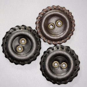 Black and brown leather buttons with gromments