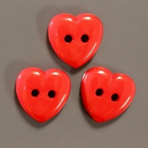 Three red heart shaped buttons