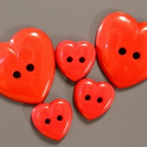 Large and small red heart shaped buttons