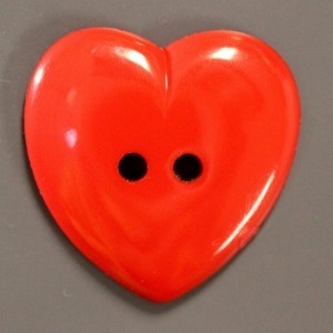 Large red heart shaped button