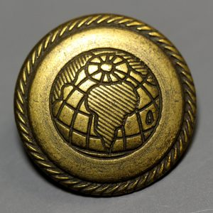 Gold metal button with map