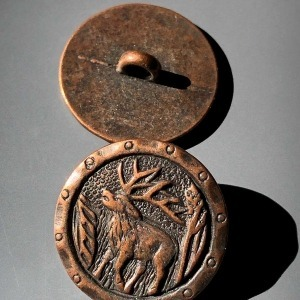 Metal button with stag image